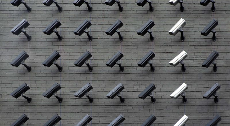 wall of surveillance cameras